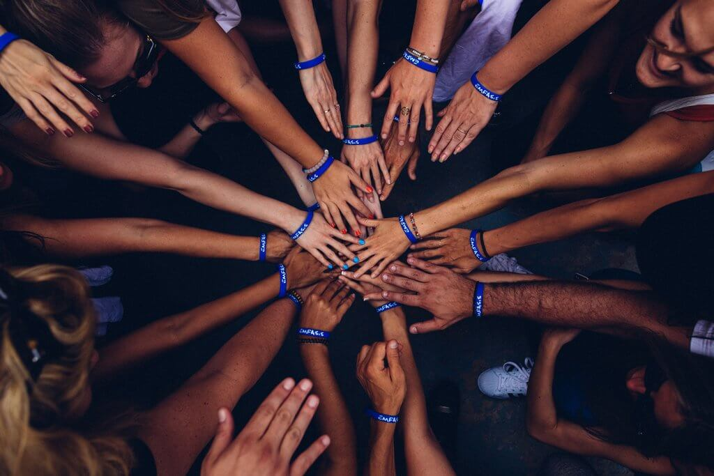 It is showing group of hands