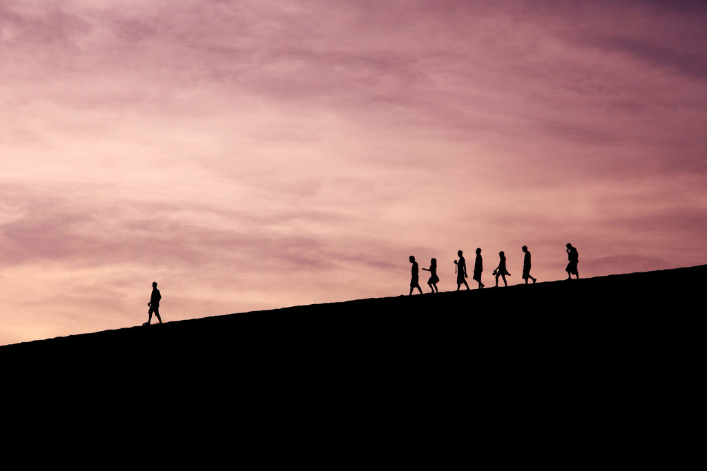 a leader leading his team