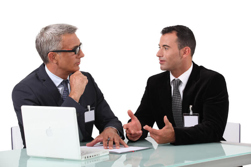 two man communicating and both have confident and interested body language