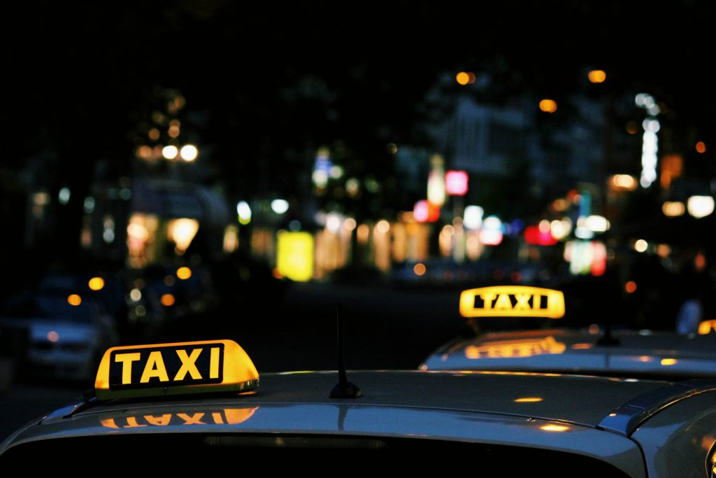 taxi signs one behind each other
