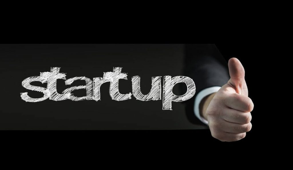 startup business written with a thumbs up