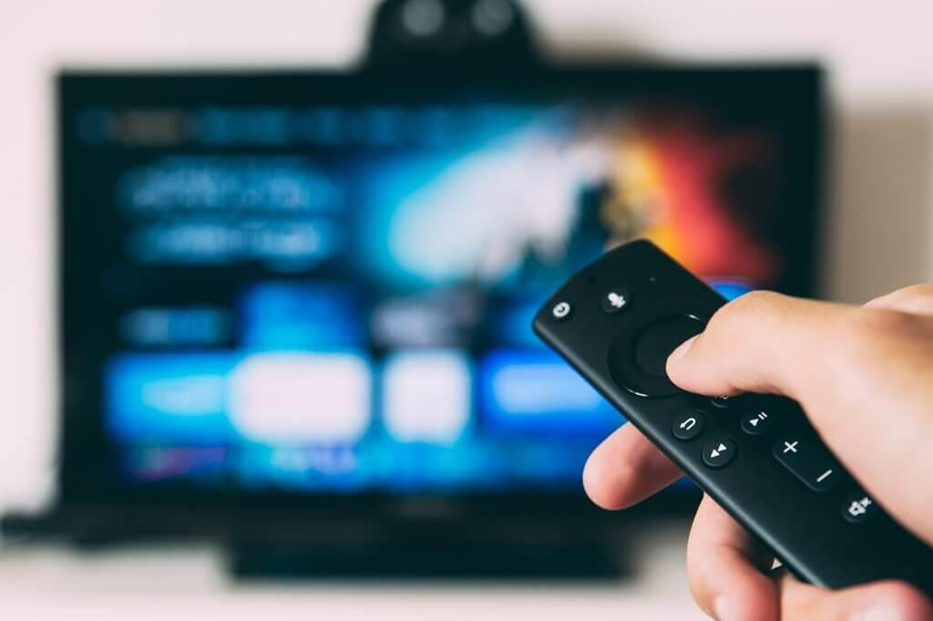 Man-Operating-Smart-TV-with-Remote