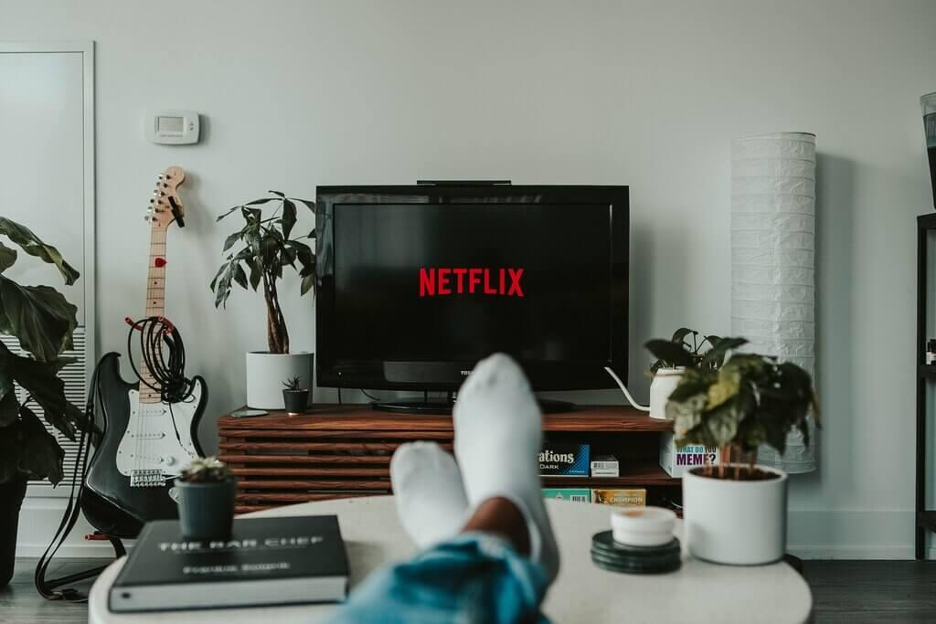 a person watching netflix on android TV