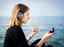 a woman listening to music with best headphones